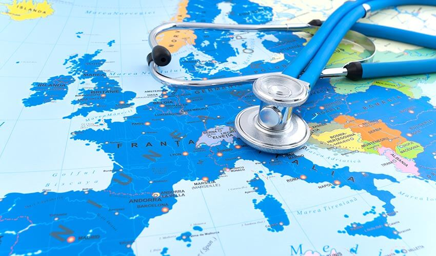 A stethoscope placed on top of a map.