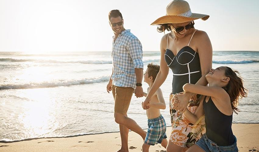 A family walking on a beach.