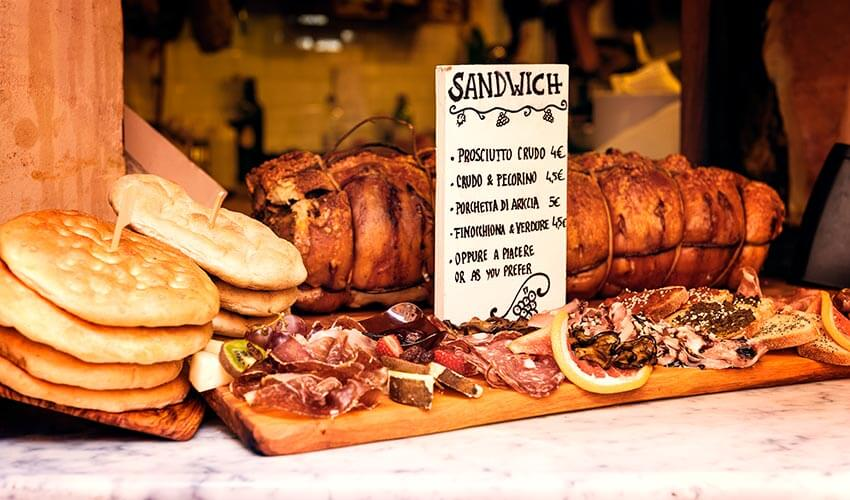 Delicious porchetta and other savories along a street in Rome.