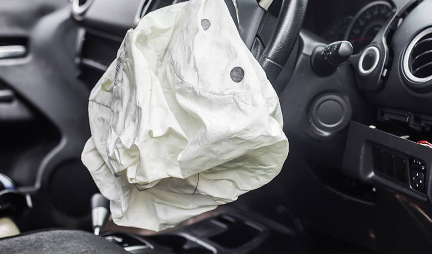 A car airbag deployed in an accident.