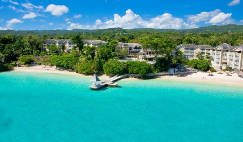 Sandals beach resort with clear blue waters.