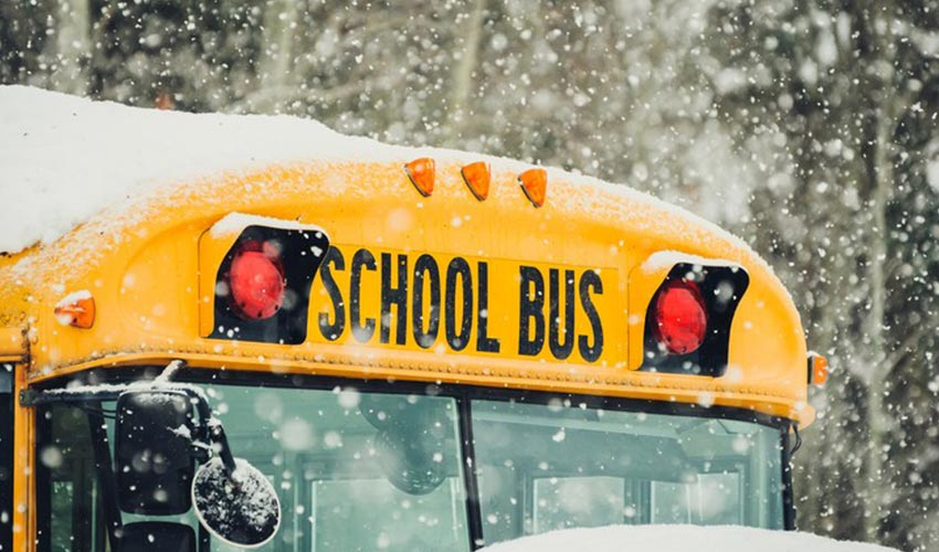 Close up view of front of school bus during winter.