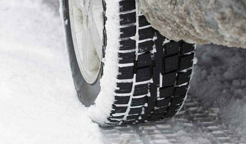 A closeup of a snow tire.