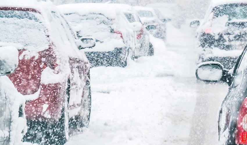 Cars stick in traffic jam during a snow storm.