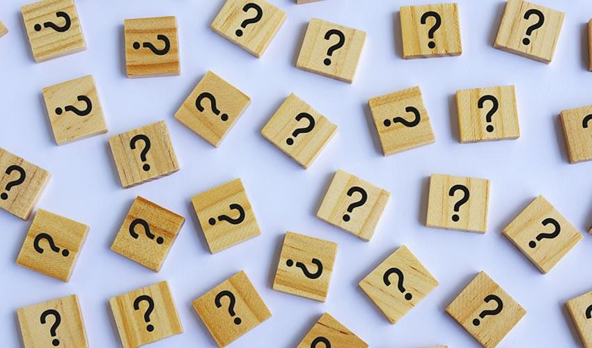 Question marks on wooden blocks.