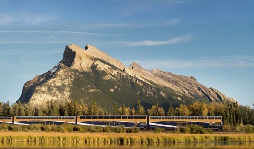 Train traveling across the Canadian Rockies.