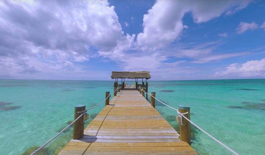 A dock surrounded by clear waters at Compass Point, New Providence Island.