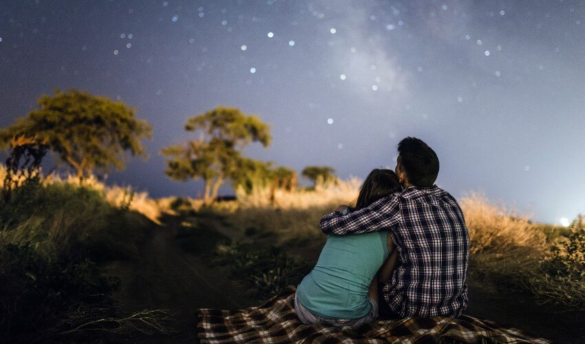 Couple in love under the stars of Milky Way Galaxy Odessa.
