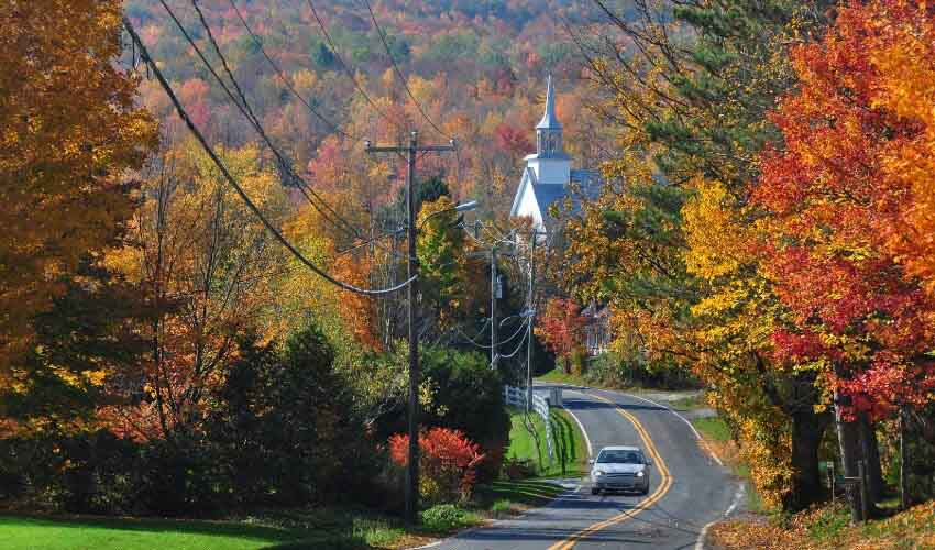 Country road in autumn with colourful foliage in Canada.