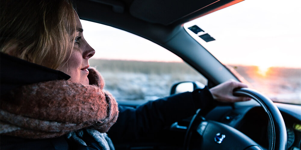 A woman drives in the winter