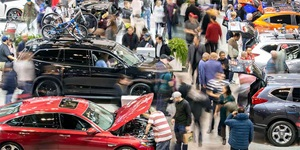 A crowd explores exhibits at the Canadian International AutoShow in Toronto, Ont.