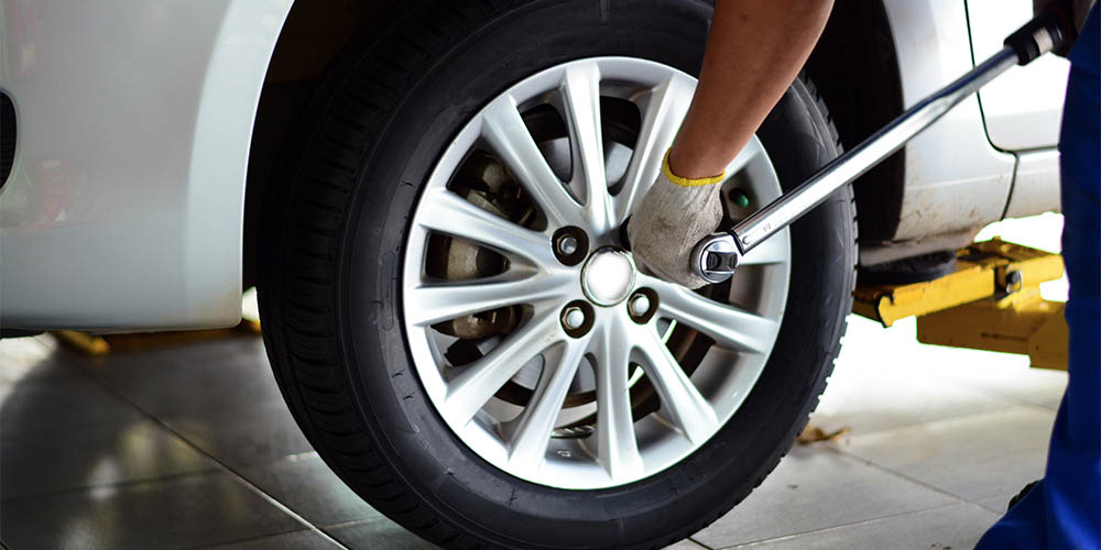 Bolts on a wheel are tightened to prevent separation.