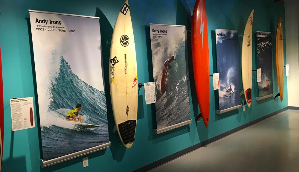 Surfboards line the walls of an exhibit at the California Surf Museum
