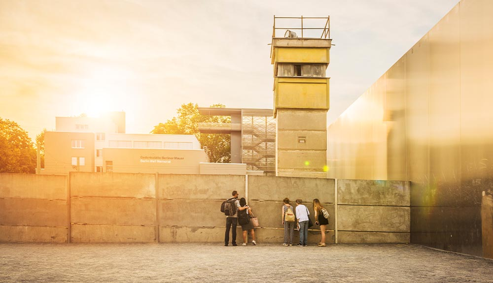 Visitors look at a section of the old Berlin Wall
