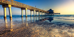 A long pier juts over the water in Florida
