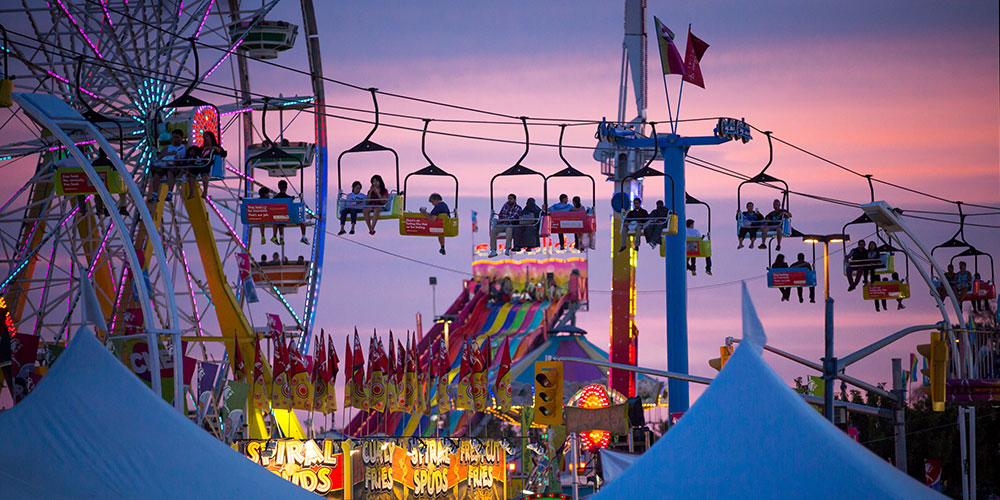 The Ferris wheel and skyway at dusk at the Canadian National Exhibition in Toronto