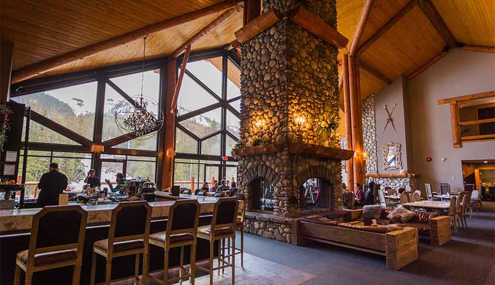 Stone fireplace at Cirque Restaurant at Lizard Creek Lodge in Fernie, B.C., Canada