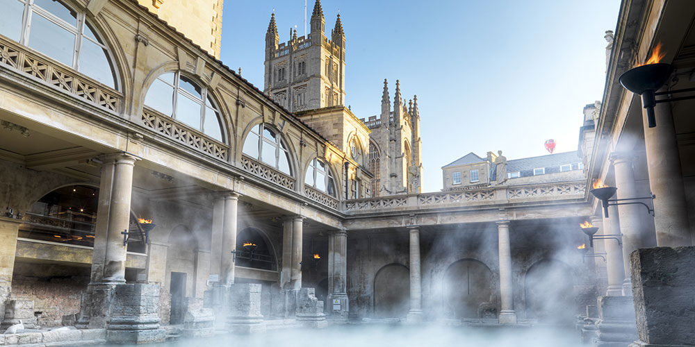 Steam rising from the waters in the courtyard of a stunning building in a small city off the beaten path