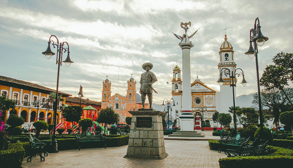 A statue stands in Puebla, Mexico, surrounded by stunning architecture
