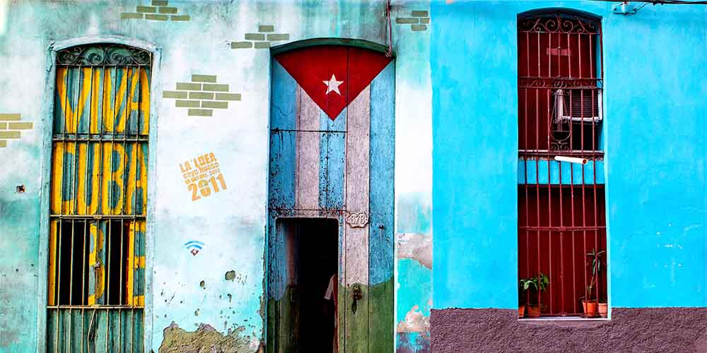 The Viva Cuba slogan and the Cuban flag decorate doorways in Havana