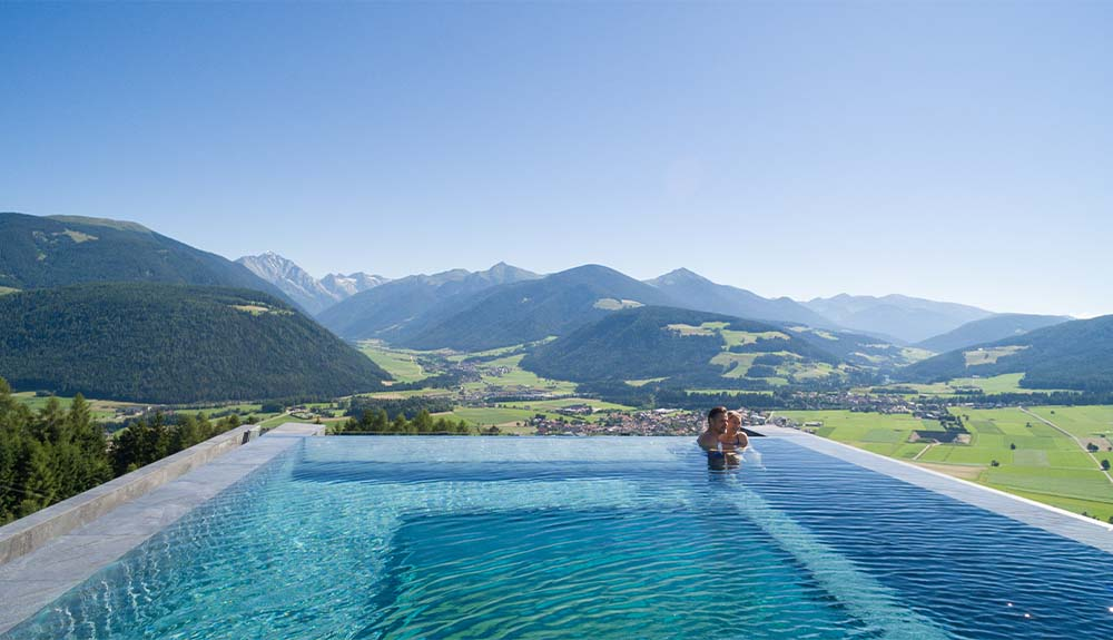 The infinity pool at the Alpin Panorama Hotel Hubertus in South Tyrol, Italy looks out at the Dolomite Mountains