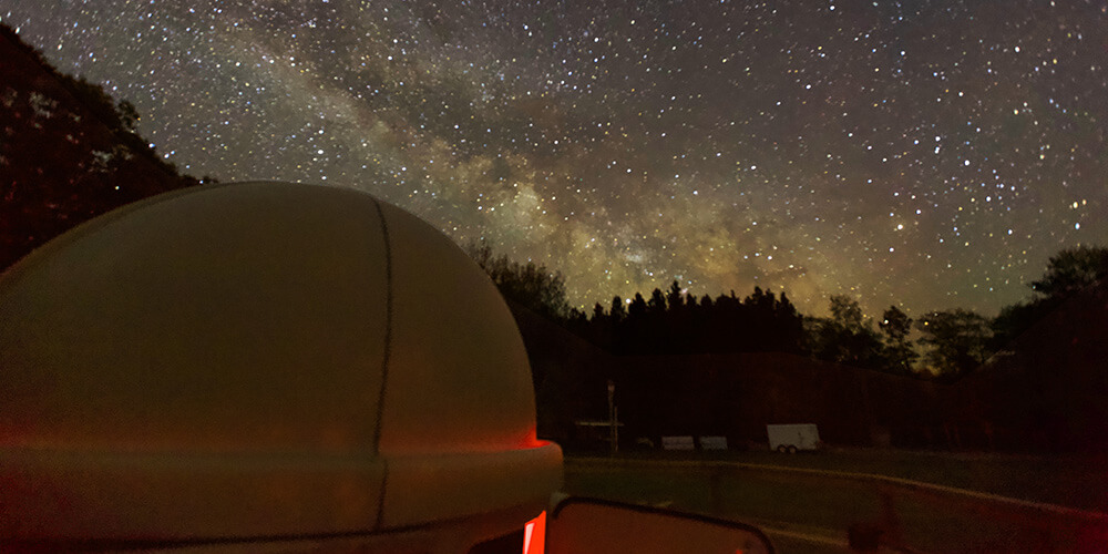 Looking over the roof of the observatory to a starry night sky at Killarney Provincial Park in Ontario