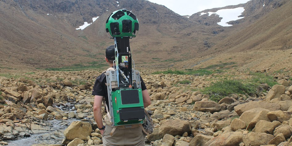 Backpacking through valley with mapping camera