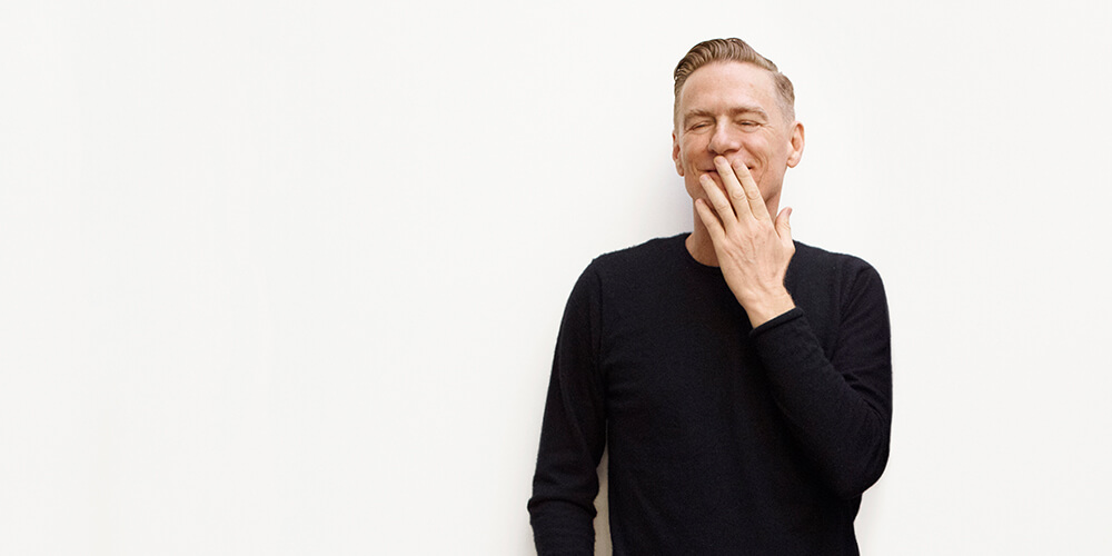 Singer Bryan Adams dressed in a black shirt