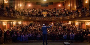 Comedian James Mullinger on stage in front of a packed house at the Imperial Theatre in Saint John, New Brunswick