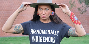 "Sarain Fox wearing a t-shirt that says ""Phenomenally Indegenous"""