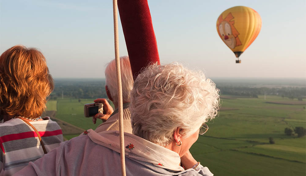 Older couple riding in a hot-air balloon