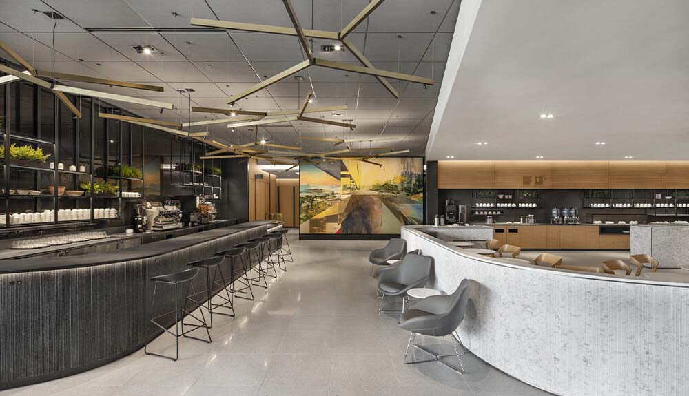 Bar seating and cafe area at the new Air Canada Cafe lounge at Toronto Pearson Airport