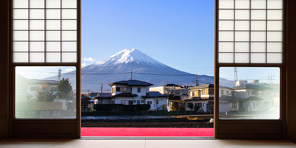 The view of Mount Fuji is seen from sliding doors at a Japanese hotel