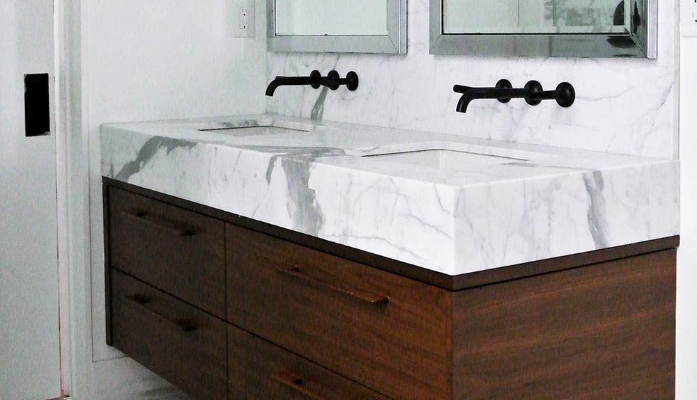 Double bathroom sink with two drawers of storage beneath