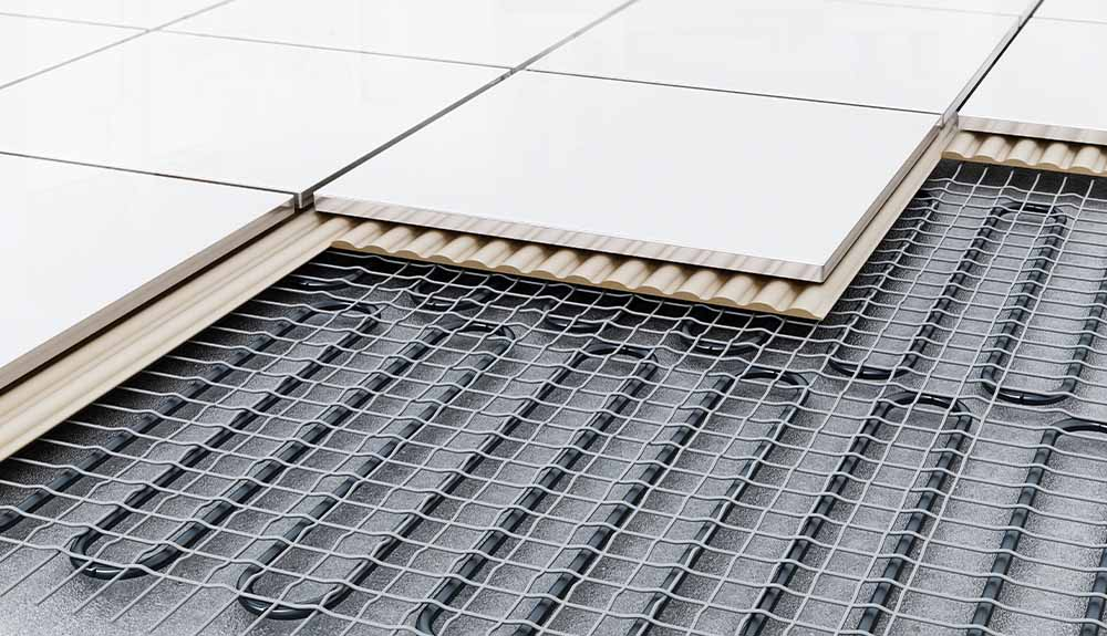 Tiles removed from a floor show the radiant heating coils underneath.