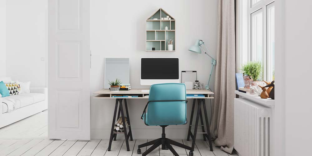 A home office is shown with white furniture and a blue chair