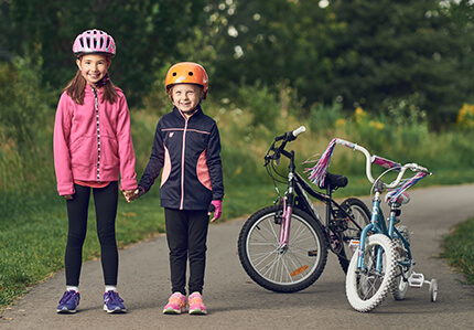 Children wearing cycling helmet