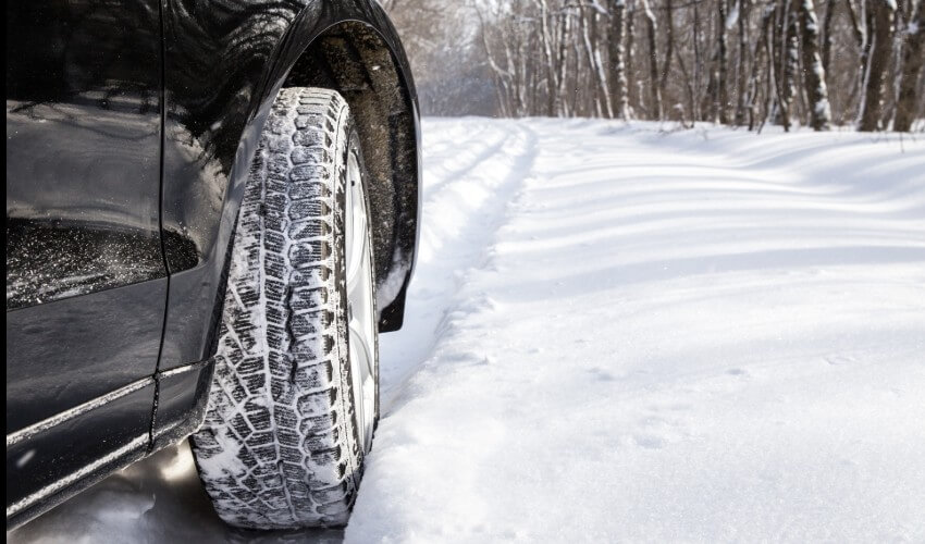 Winter tire of car driving in show.
