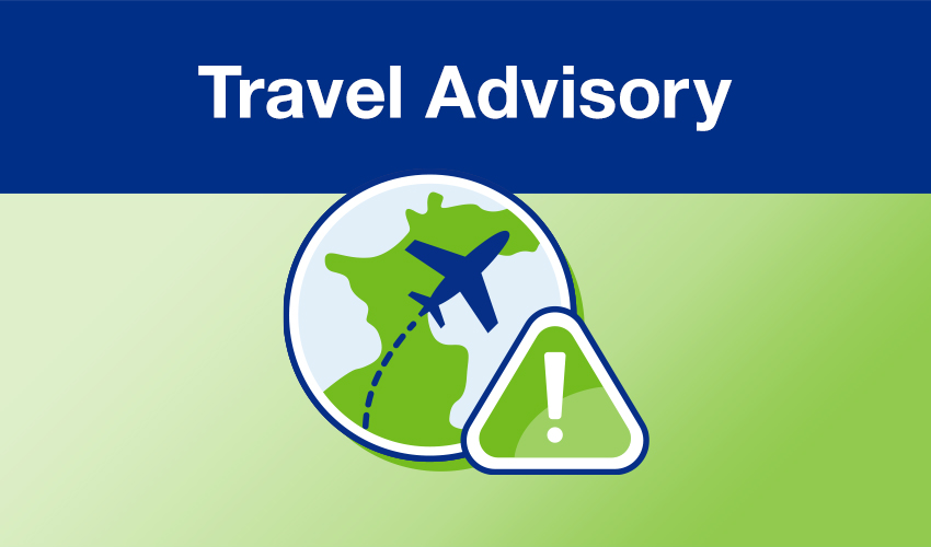 Travel advisory illustration of a plane flying over the globe and an exclamation mark warning sign.