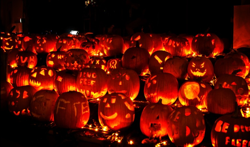 Pumpkins lit up at night