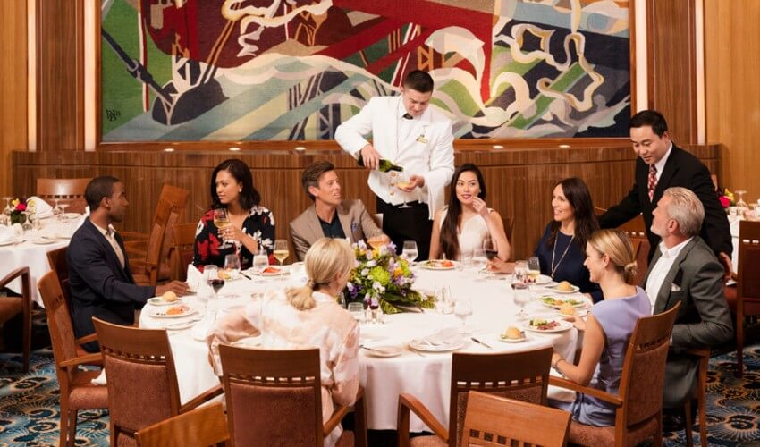 Group of travelers dining onboard the Cunard Ship.