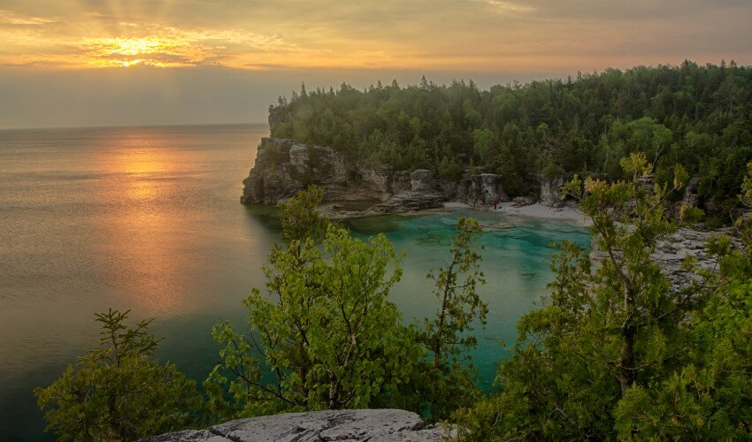 Elevated view of sunrise over rocky shoreline of Bruce Peninsula National Park.