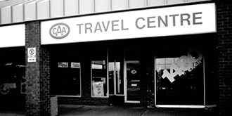 Black and white photo from 1961 showing the storefront of a CAA Travel Centre