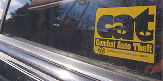 CAT - Combat Auto Theft logo on car window