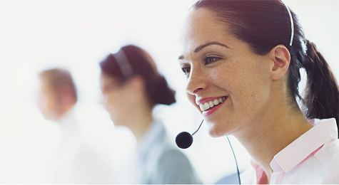Customer service agent smiling.