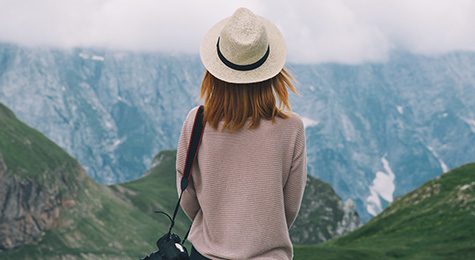 Woman travelling along mountains