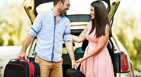 Couple unpacking suitcases