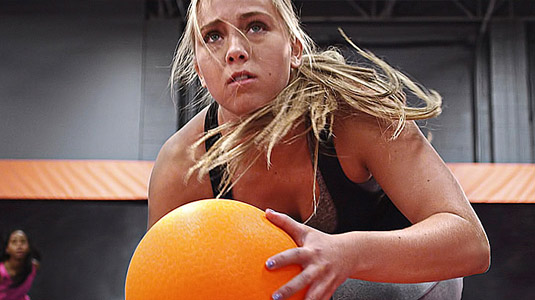 Girl holding ball at Skyzone