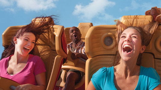Teenagers on rollercoaster ride