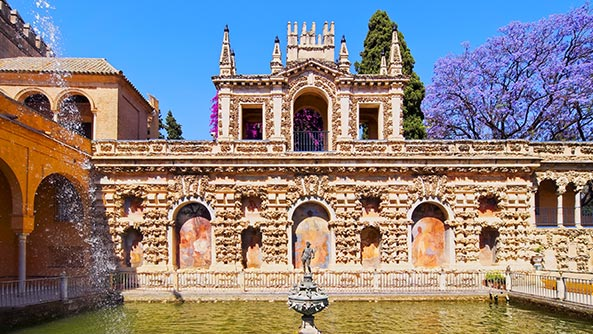 Fountains in the Gardens in Alcazar of Seville in Spain